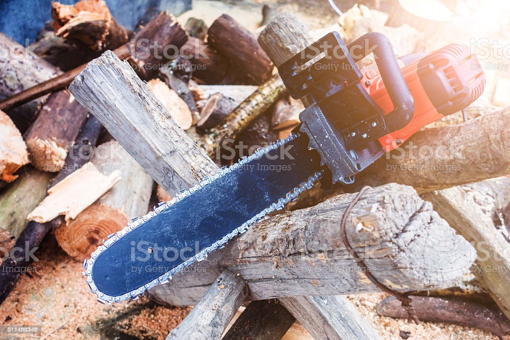 firewood and chainsaw stock photo
