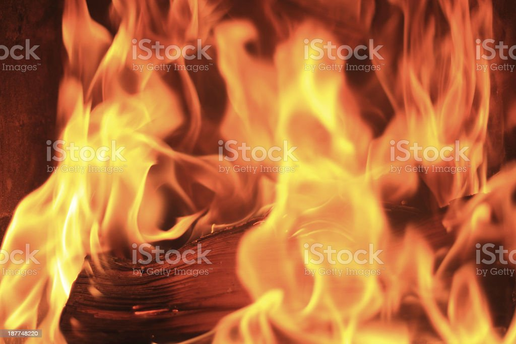 firewood at fire in a fireplace stock photo