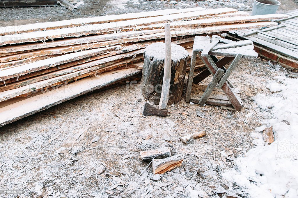 Firewood chopping workplace frosted by snow stock photo