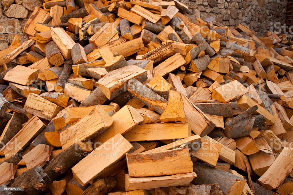 firewood in the yard prepared for winter stock photo