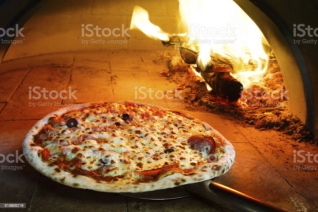 Firewood oven pizza stock photo