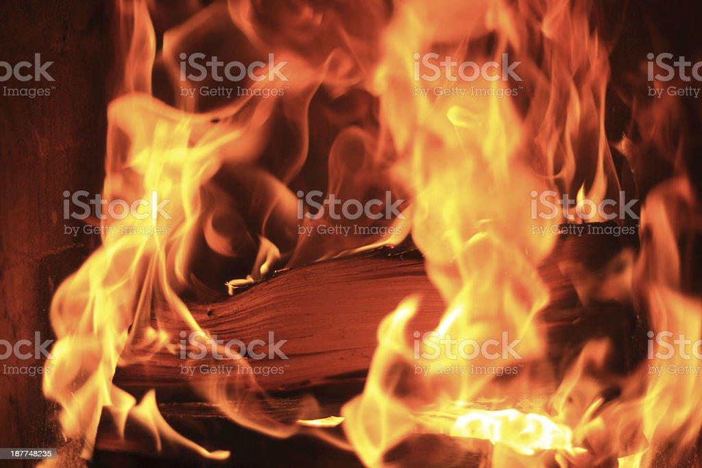 firewood producing heat stock photo