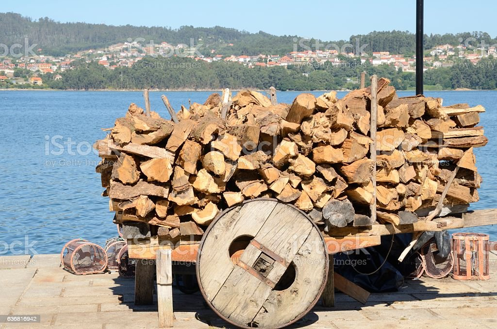Firewood stacked in Combarro stock photo