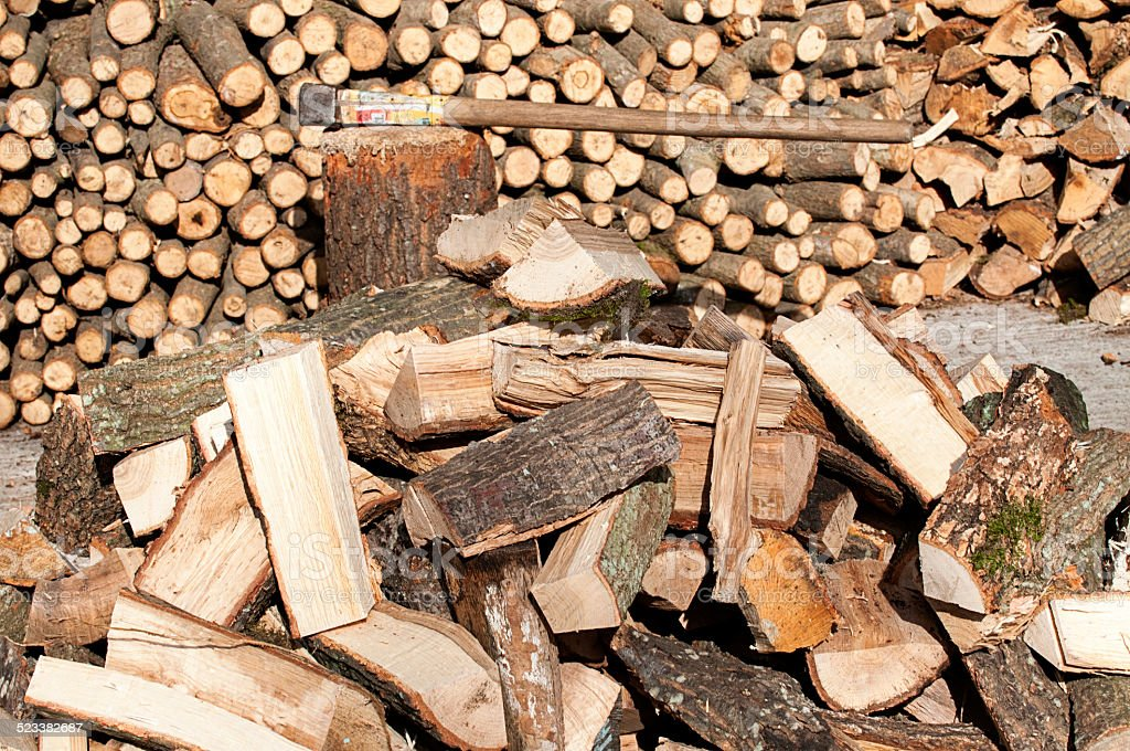 Firewoods and axe stock photo