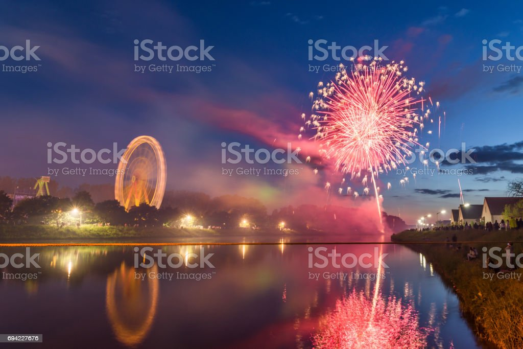 Firework at folk festival with ferris wheel in Regensburg stock photo