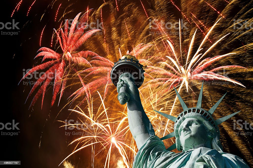 Firework display and the Statue of Liberty royalty-free stock photo