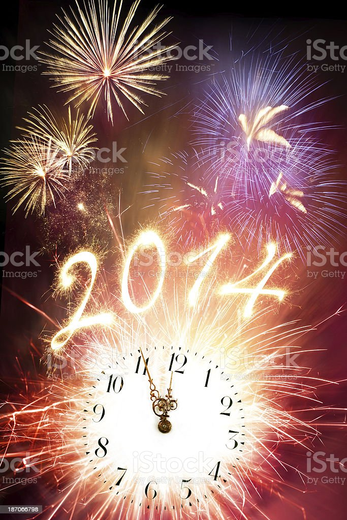Firework Display With Clock And Sparkling New Year's 2014 royalty-free stock photo