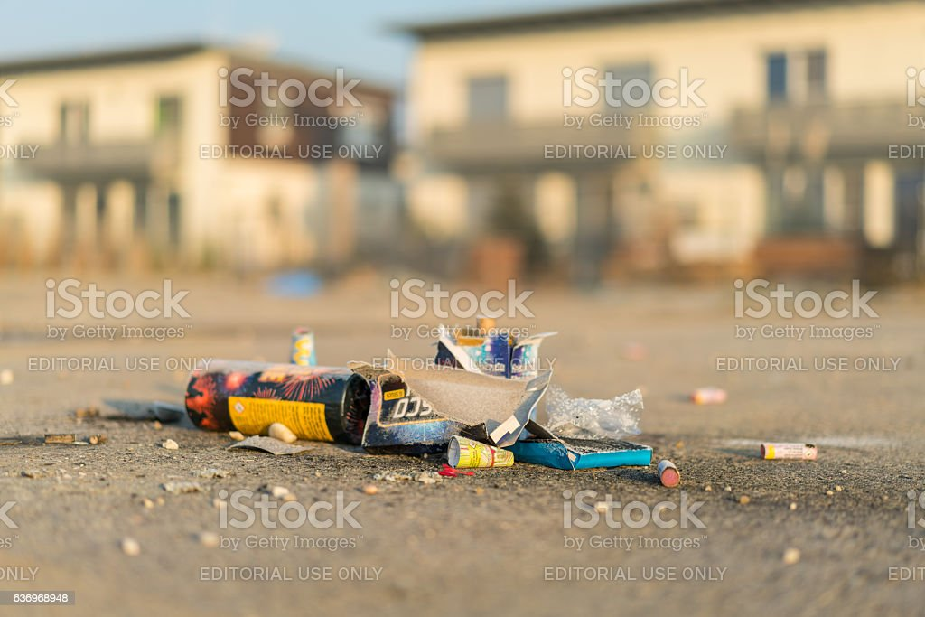 firework leftovers with european houses stock photo