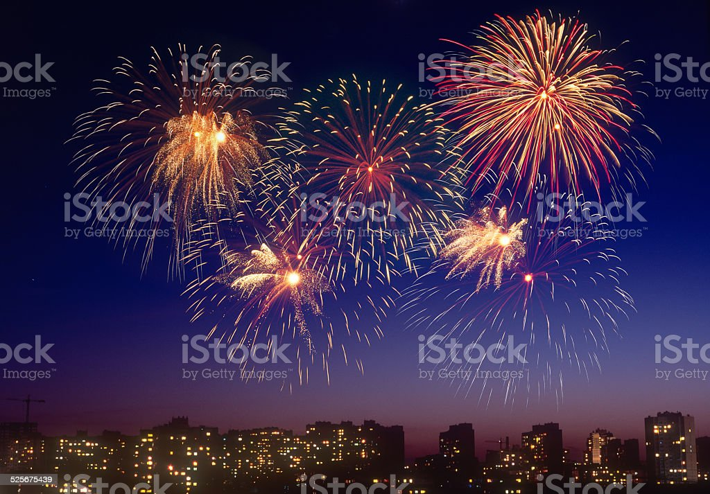 Firework over a city. stock photo