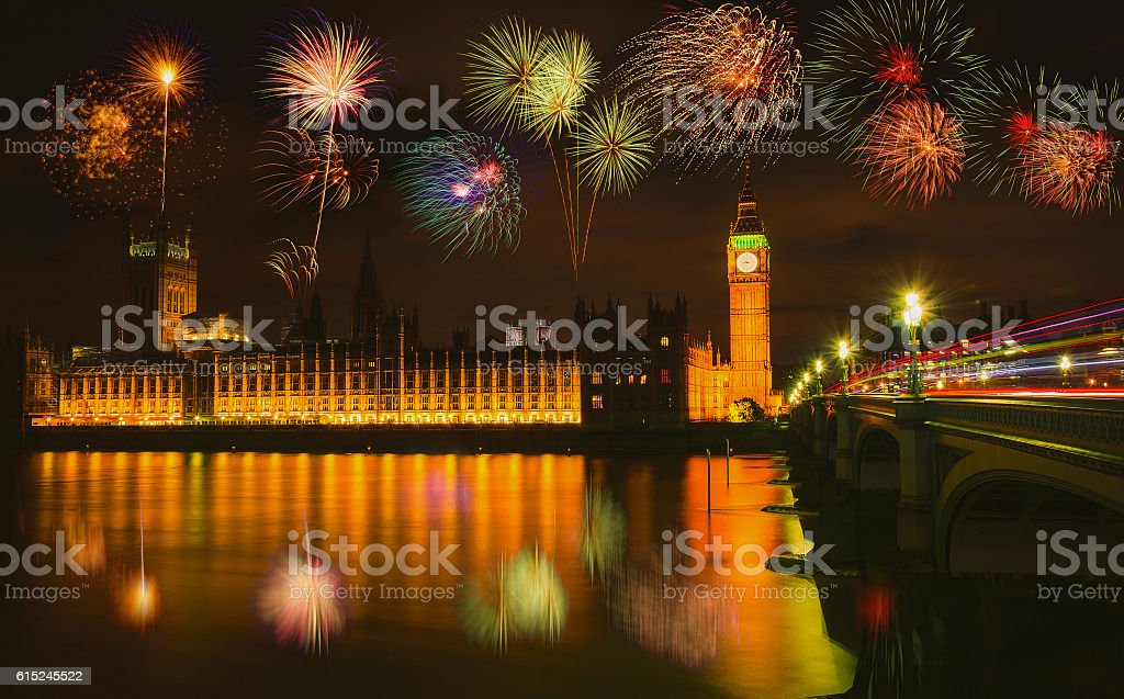 Firework over Big Ben at night in London, UK. stock photo