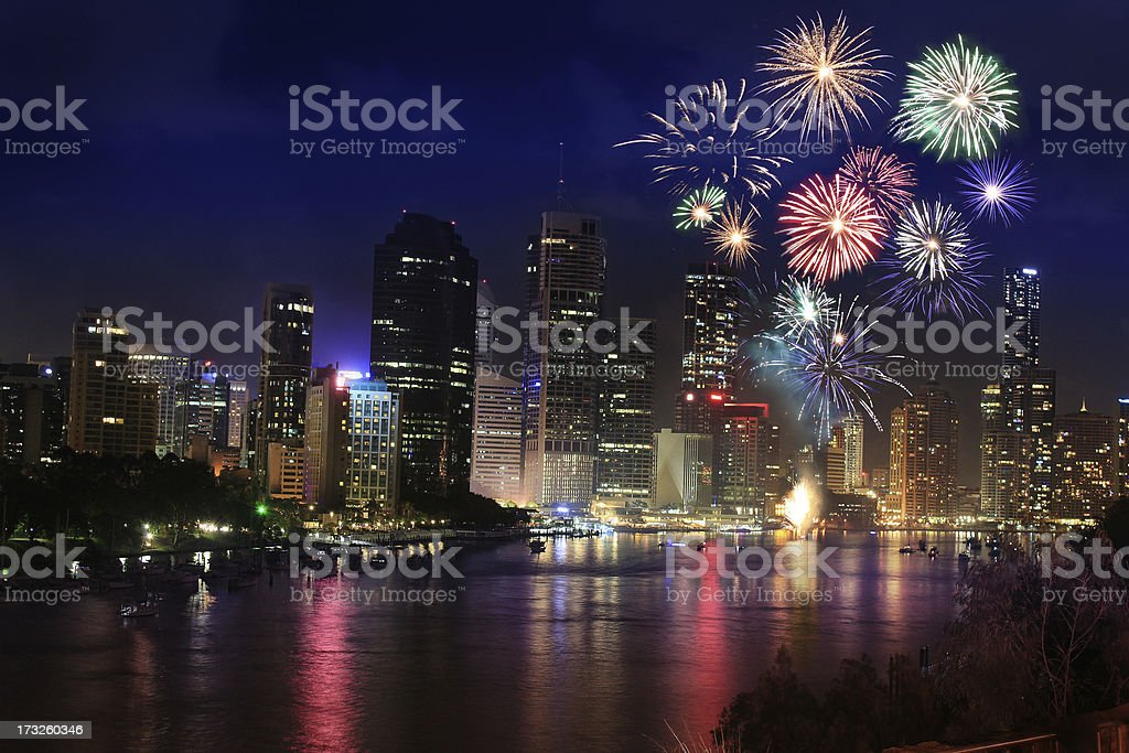 Firework over city at night with reflection in water stock photo