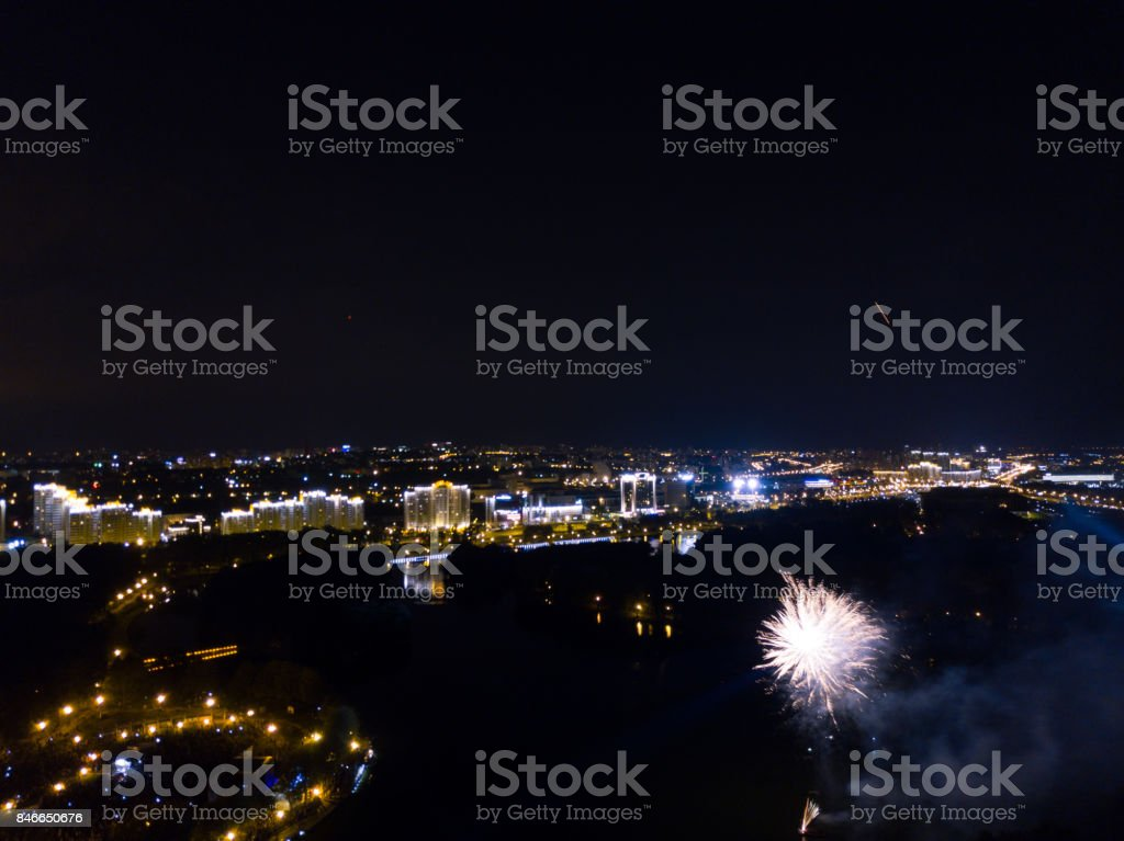 Firework shoot from drone. River and night city view. Musical festival end stock photo