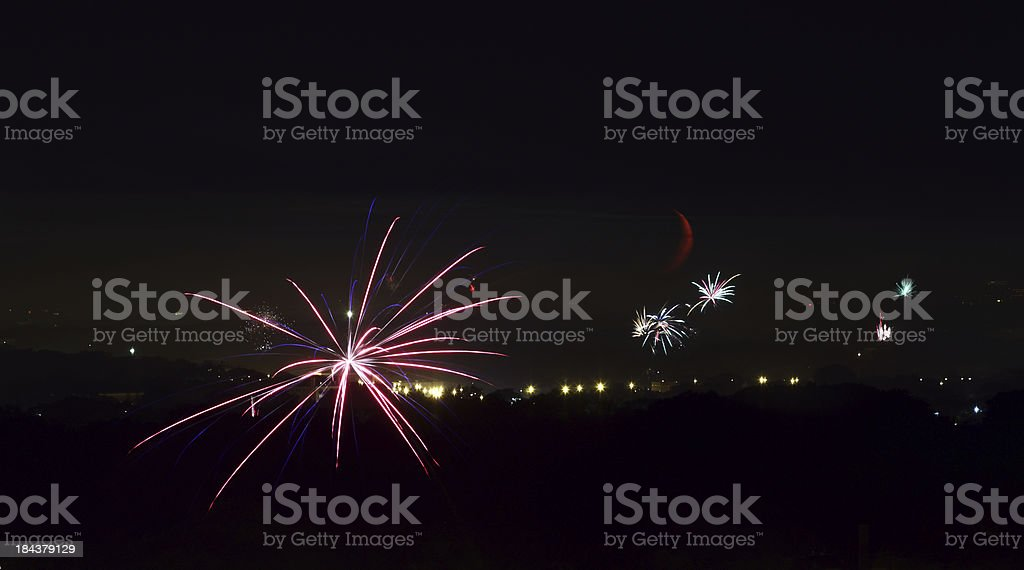 fireworks against the setting moon royalty-free stock photo