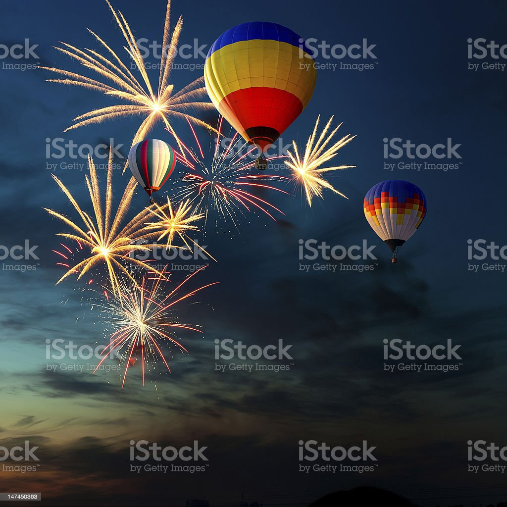 fireworks and hot air-balloon at sunset royalty-free stock photo