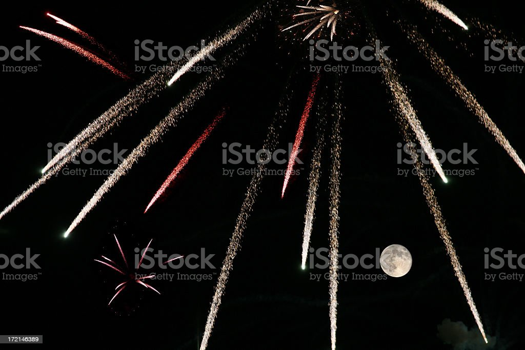 Fireworks and Moon stock photo