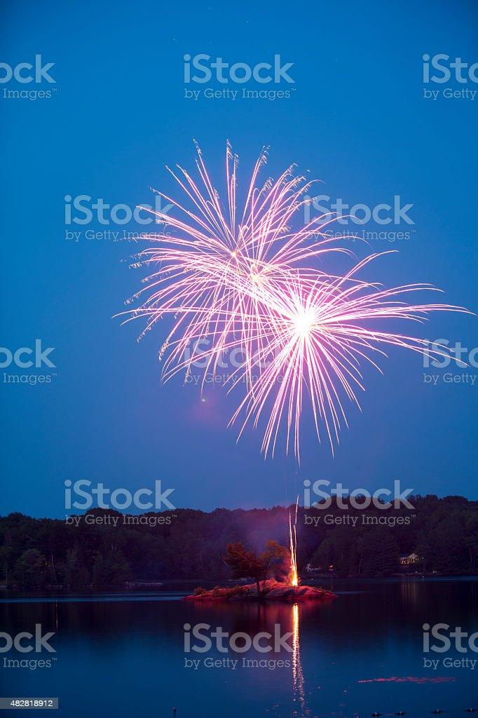 Fireworks at dusk stock photo