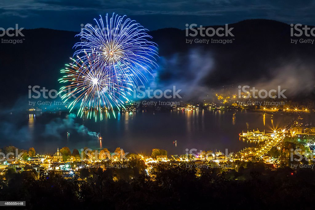 Fireworks at night over Lake George NY during Octoberfest stock photo