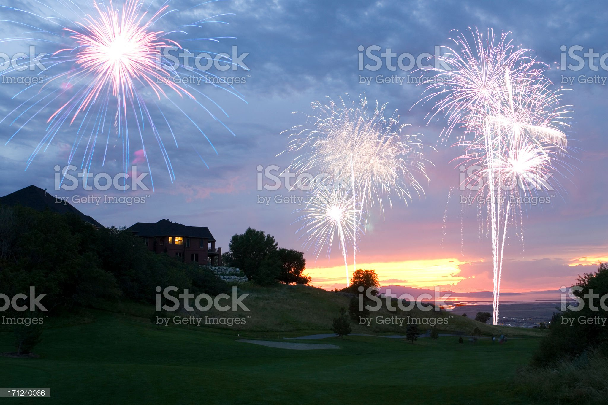 Fireworks at Sunset Over Golf Course royalty-free stock photo