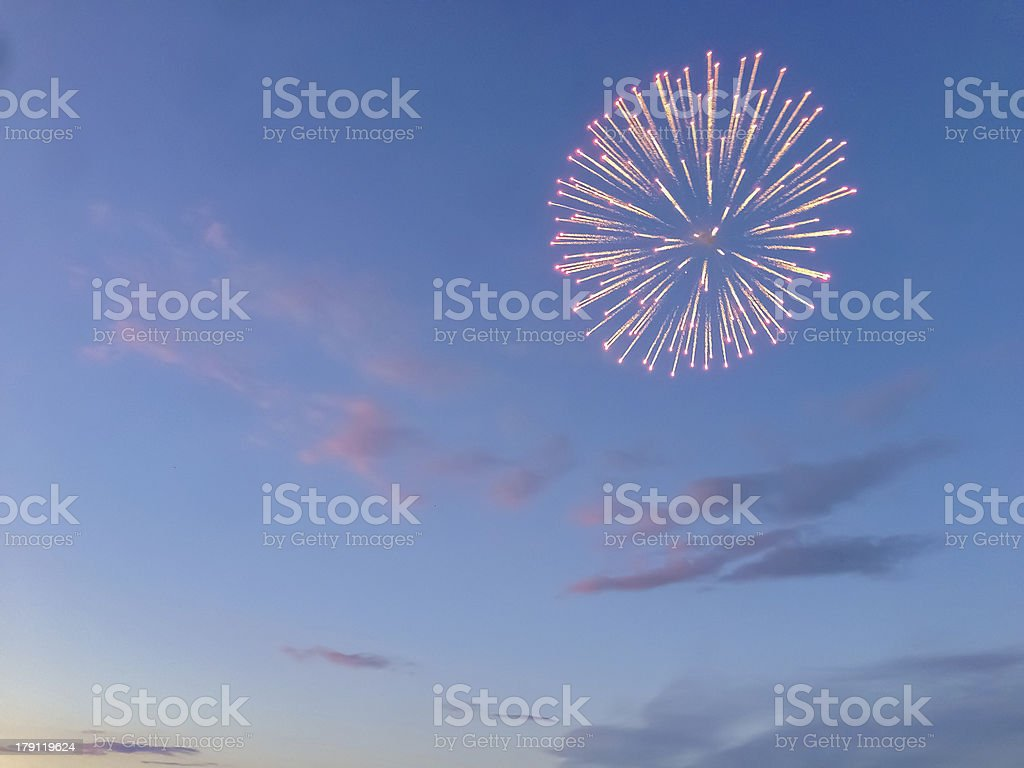 Fireworks at sunset stock photo