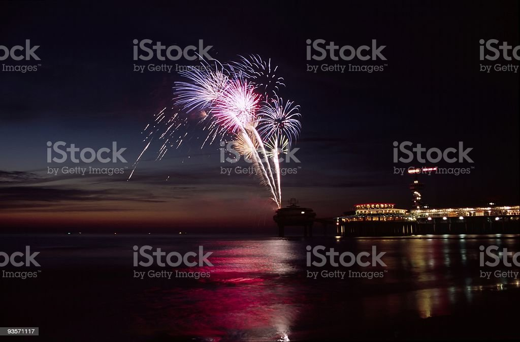 Fireworks at the beach during sunset royalty-free stock photo