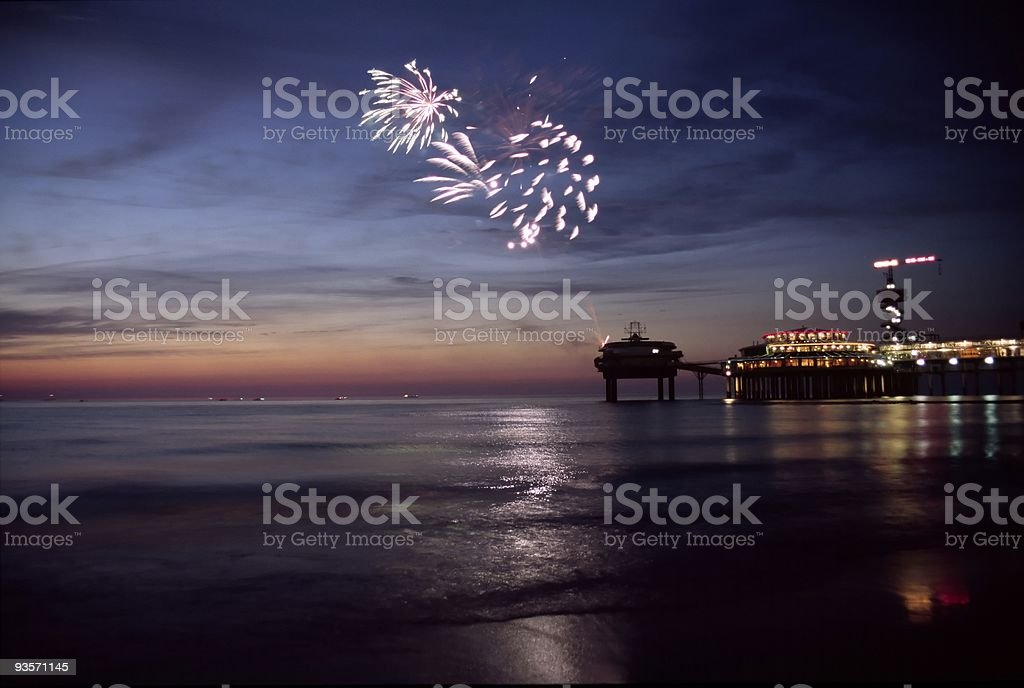 Fireworks at the beach during sunset stock photo
