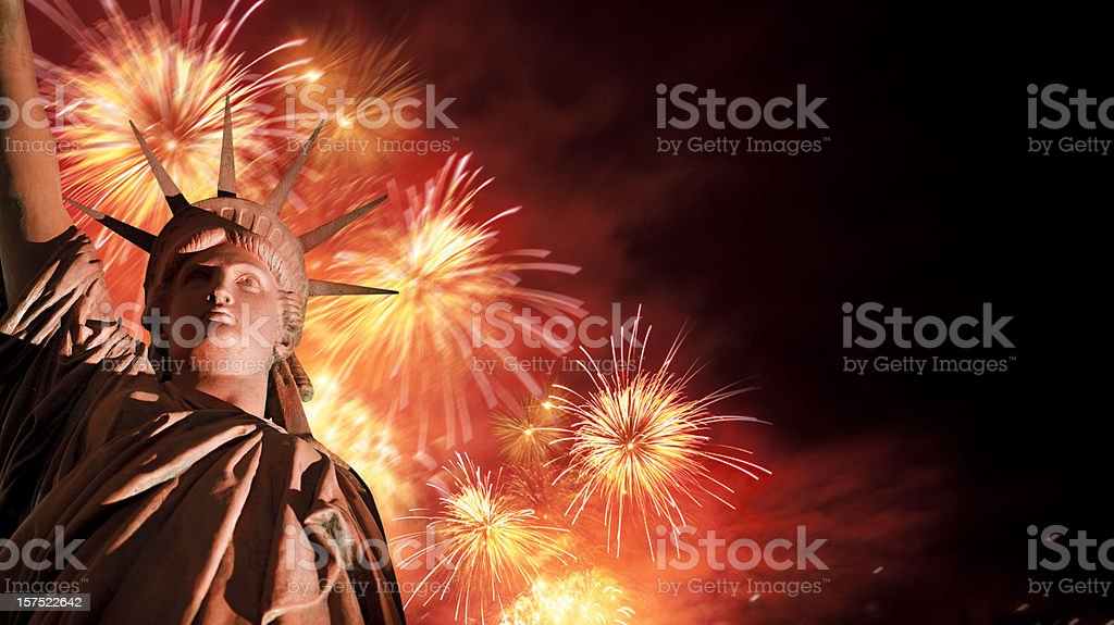Fireworks behind Statue of Liberty royalty-free stock photo