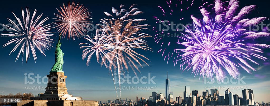 fireworks behind the statue of liberty stock photo