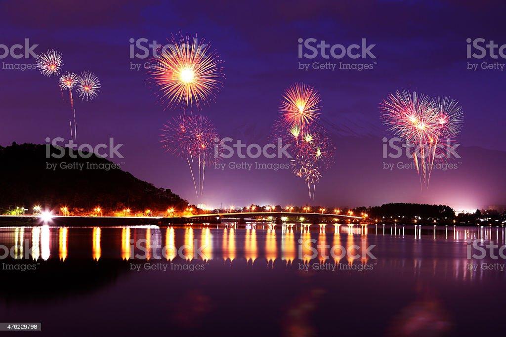 Fireworks celebrating over Lake Kawaguchiko at night with mount stock photo