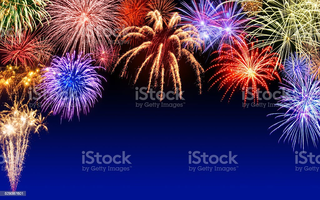 Fireworks display on dark blue stock photo