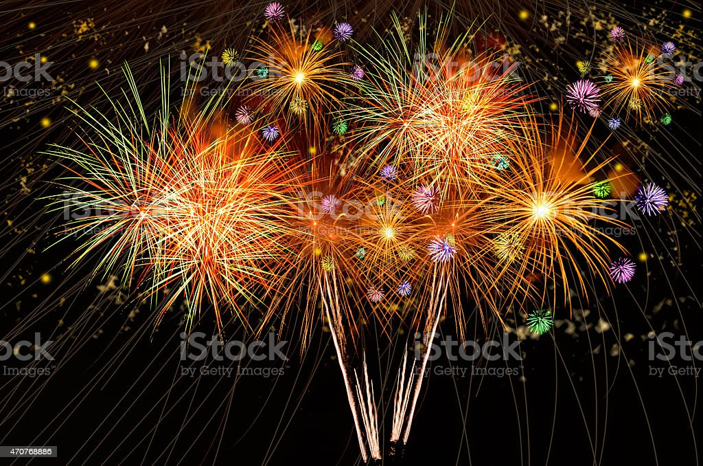 Fireworks exploding in the black of the night sky stock photo