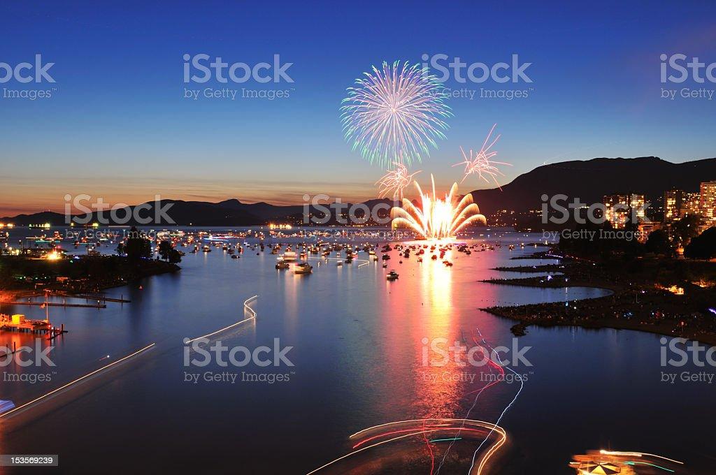 Fireworks exploding over English Bay harbor stock photo