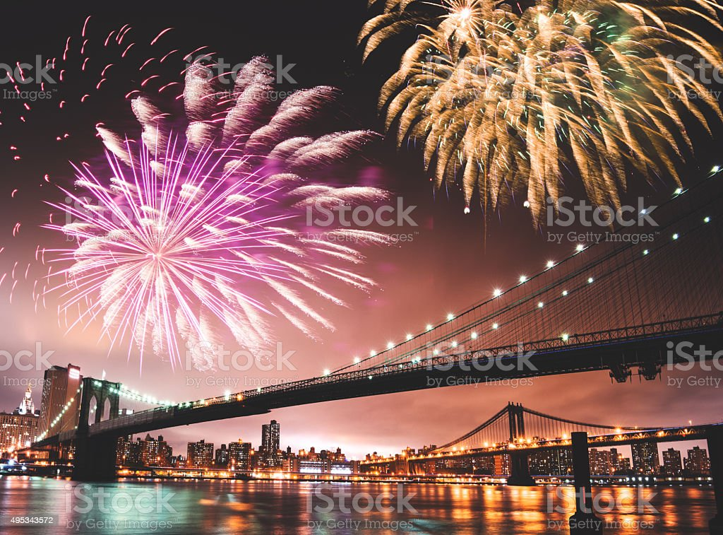 fireworks for a national holiday over the brooklyn bridge stock photo