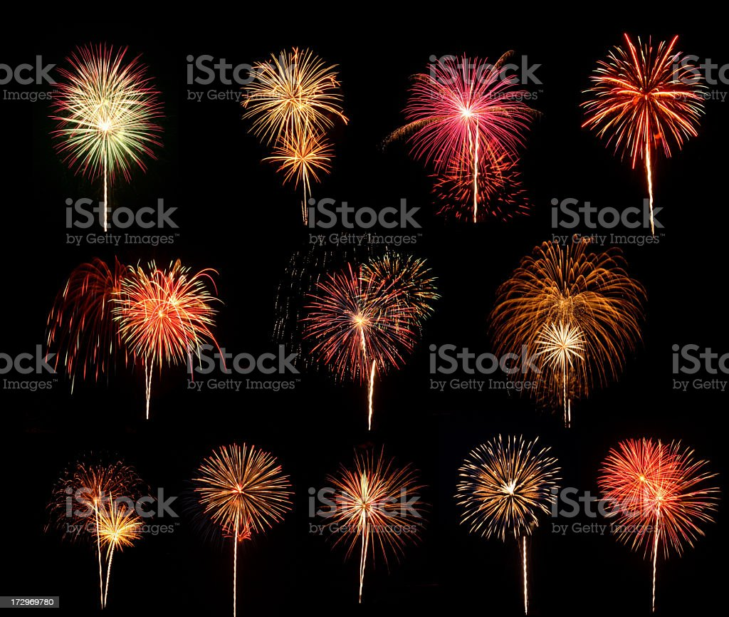 Fireworks going off in the night sky stock photo