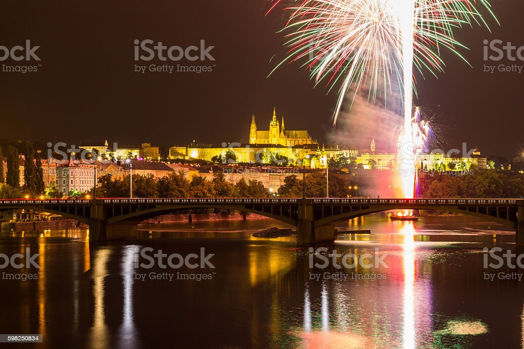 Fireworks in Prague over Vltava river, Castle and Charles bridge stock photo