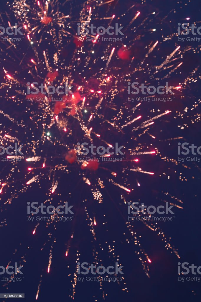 fireworks in the black sky with long trail stock photo