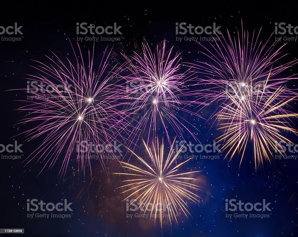 Fireworks light up the night sky in celebration royalty-free stock photo