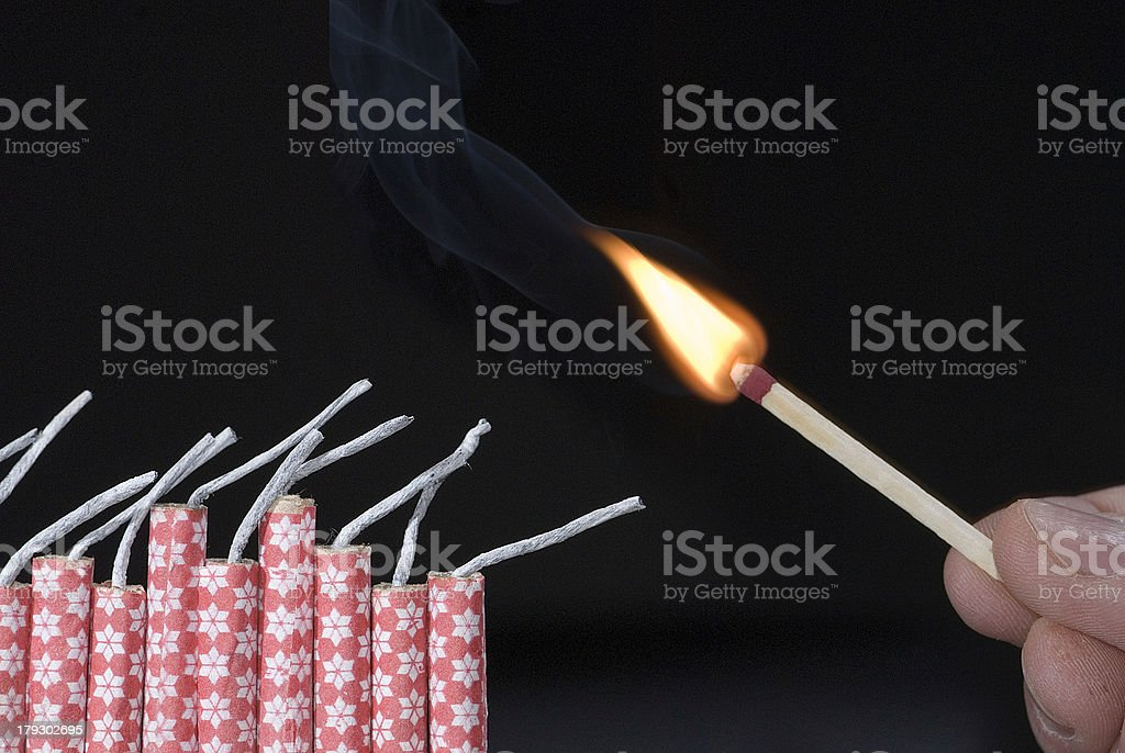Fireworks lit with flame of match 01 stock photo