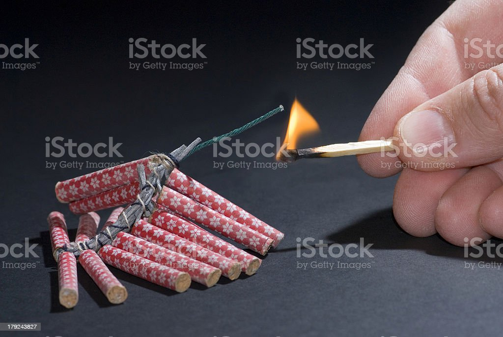 Fireworks lit with flame of match 03 royalty-free stock photo