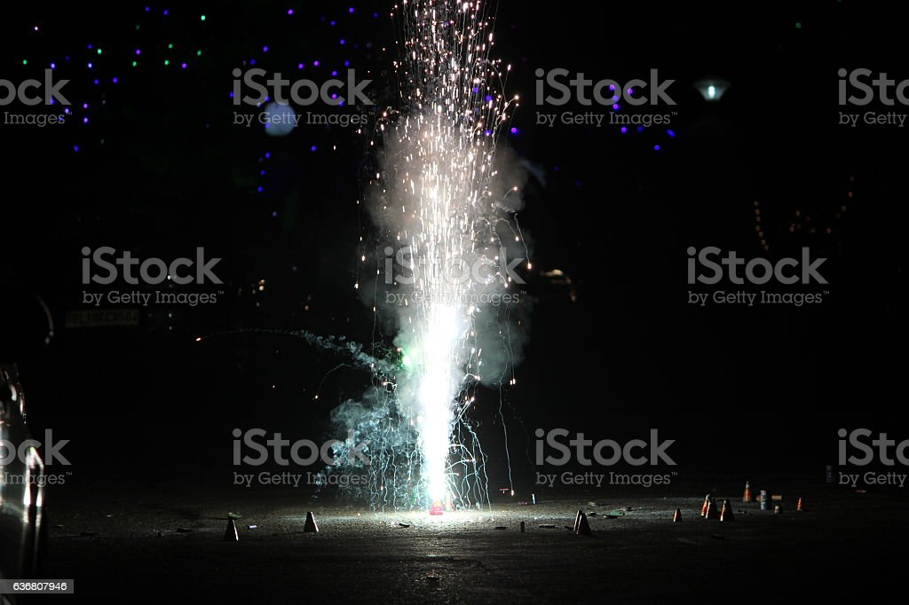 Fireworks or firecrackers during Diwali or Christmas festival stock photo