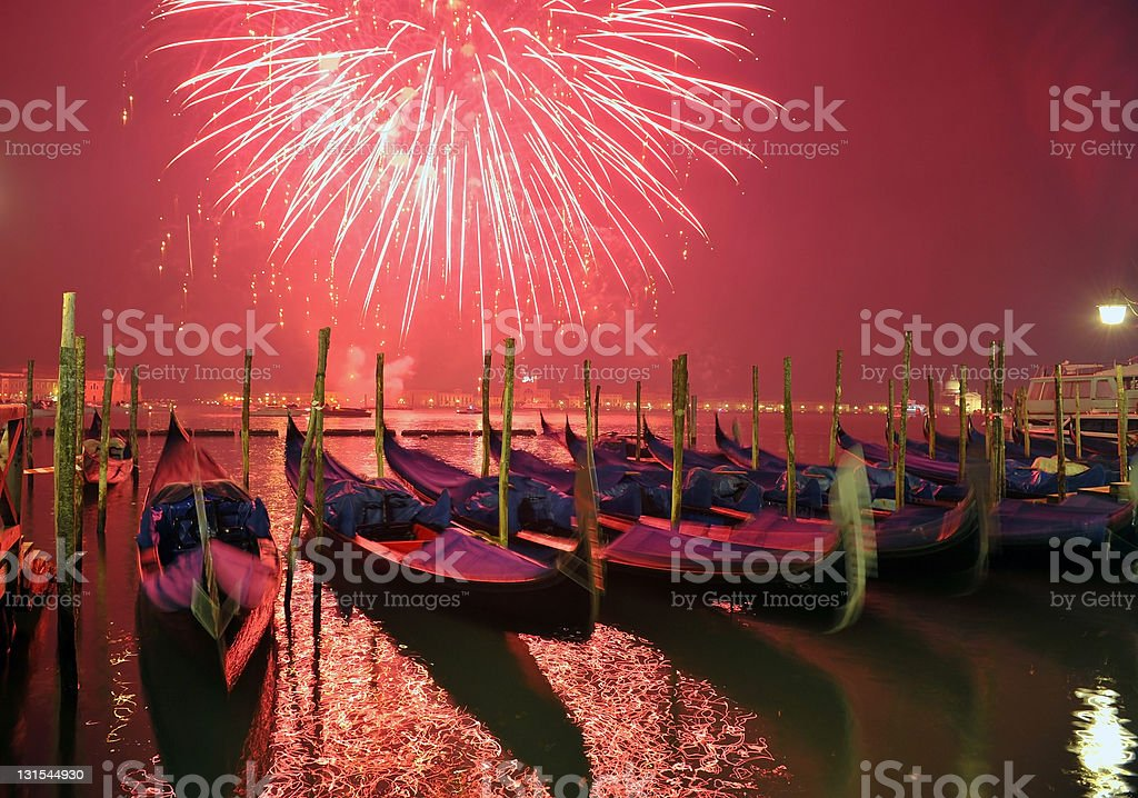 Fireworks over gondolas in Venice royalty-free stock photo