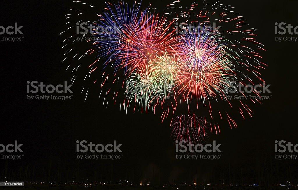 fireworks over lake stock photo