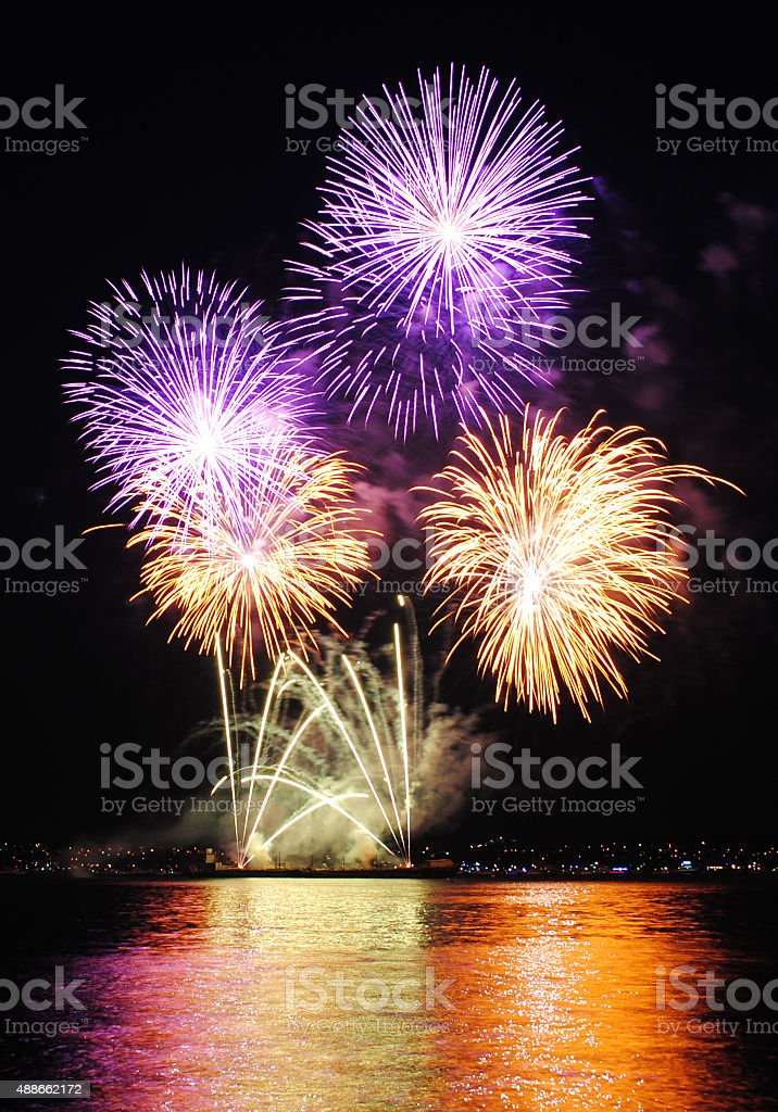 fireworks over sea stock photo