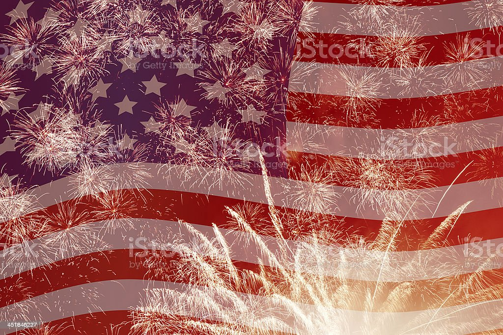 fireworks over United States flag stock photo