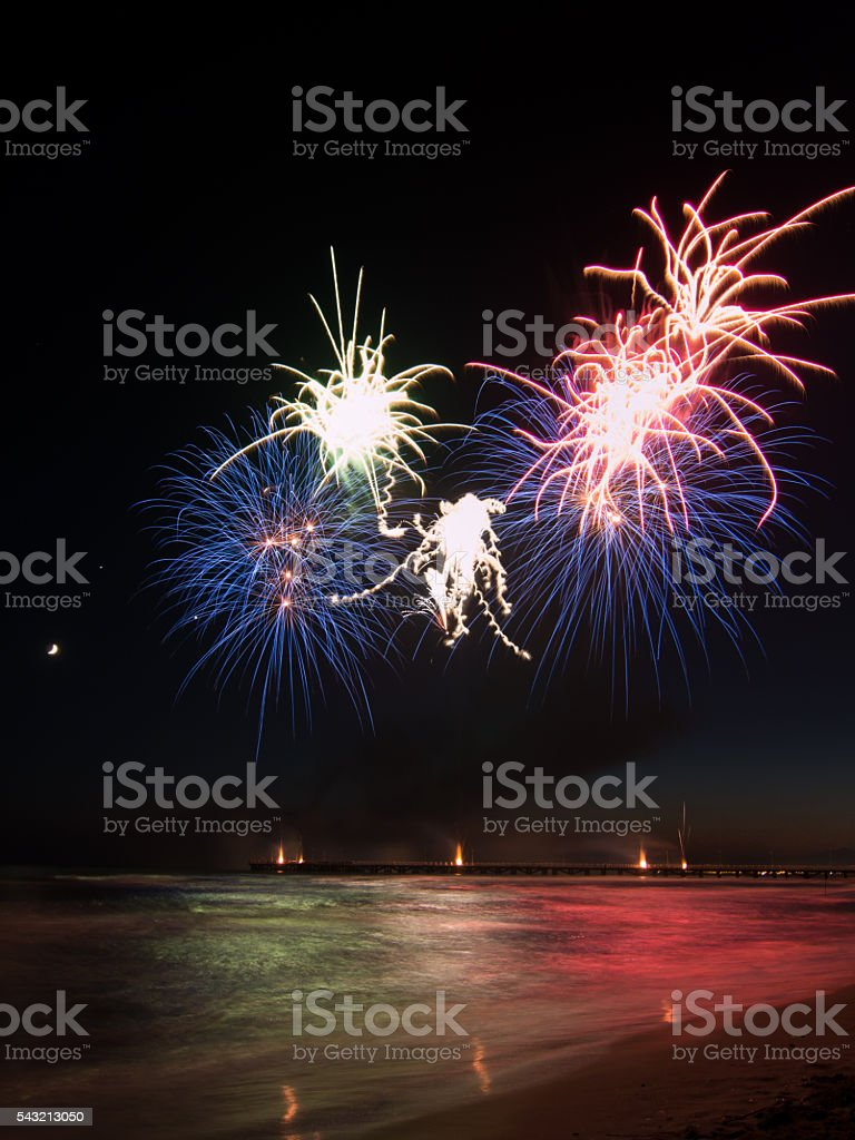 fireworks show reflecting in the water in Forte dei Marmi stock photo