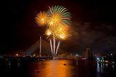 Fireworks under the bridge at night