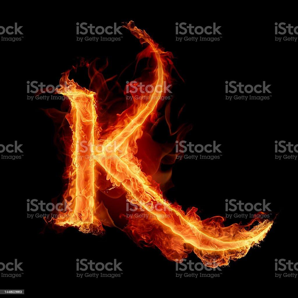 Firey font letter K on black background royalty-free stock photo
