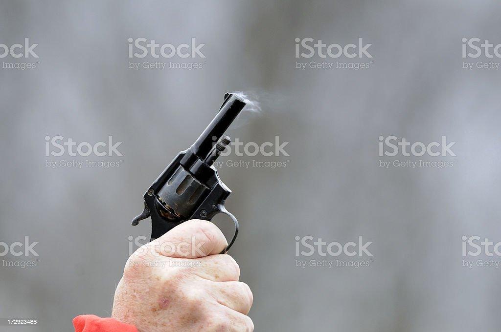 Firing a starters pistol. stock photo