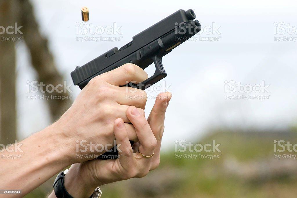 Firing gun royalty-free stock photo
