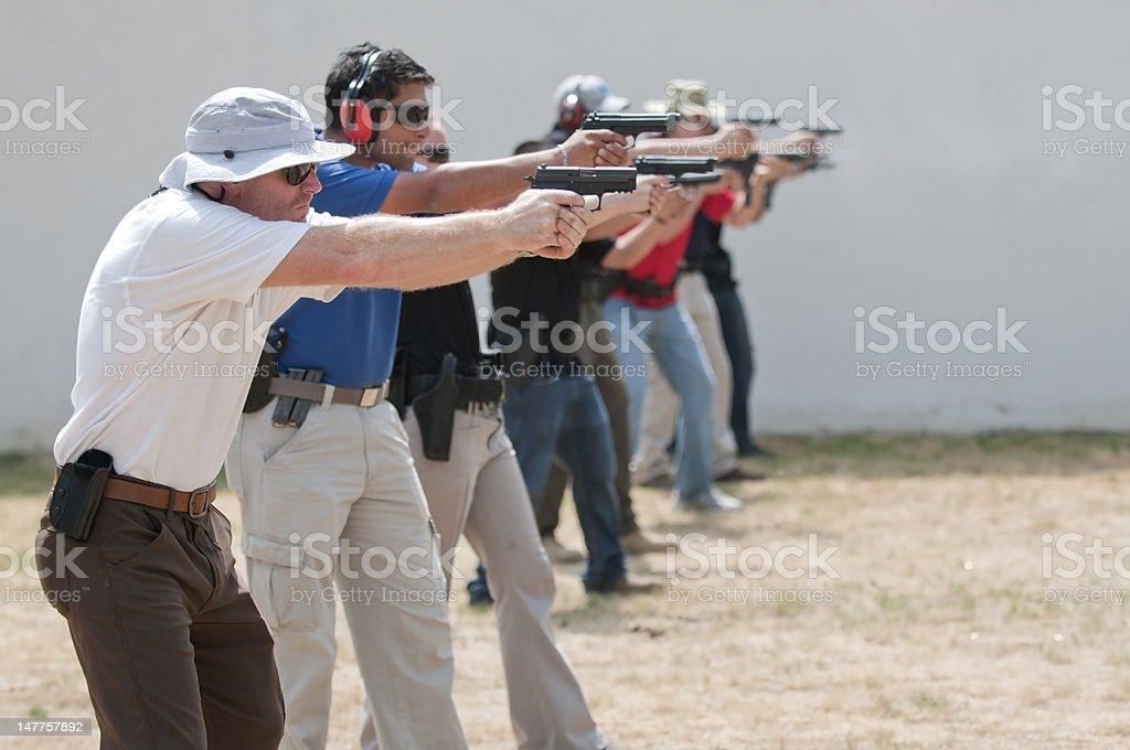 Firing Handguns on a Shooting Range stock photo