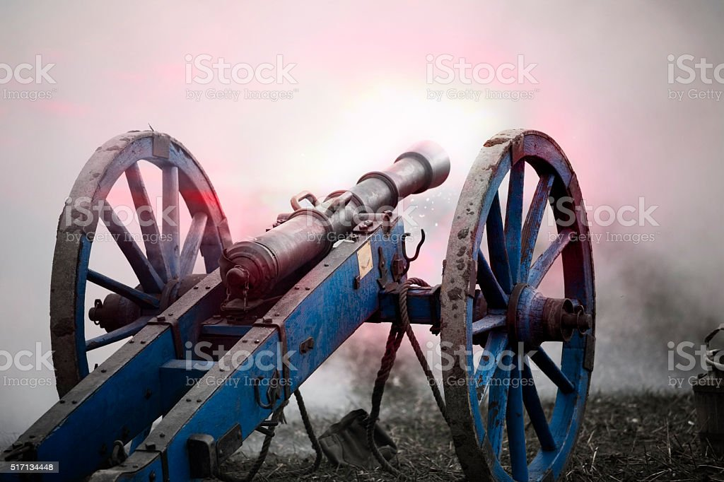 firing historic cannon and smoke of the battlefield stock photo